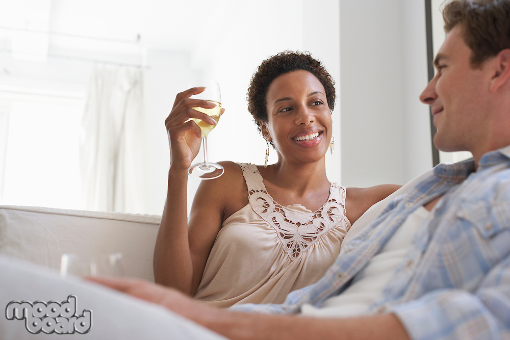 Couple Drinking Wine on Sofa