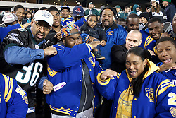 The NW Raiders celebrate with Mayor Michael Nutter and Eagles President Don Smolenski.<br /> <br /> Football players of PIAA AAA State champions Imhotep Panthers and Pop Warner Midget Div. I National Champions NW Raiders got invited to see the December 26, 2015 NFC East Division game between Washington Redskins and Philadelphia Eagles at Lincoln Financial. 9photo by Bastiaan Slabbers)