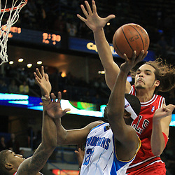 04 February 2009: New Orleans Hornets guard Devin Brown (23) shoots as Chicago Bulls center Joakim Noah (13) and Tyrus Thomas (24) defend the play during a 93-107 loss by the New Orleans Hornets to the Chicago Bulls at the New Orleans Arena in New Orleans, LA.
