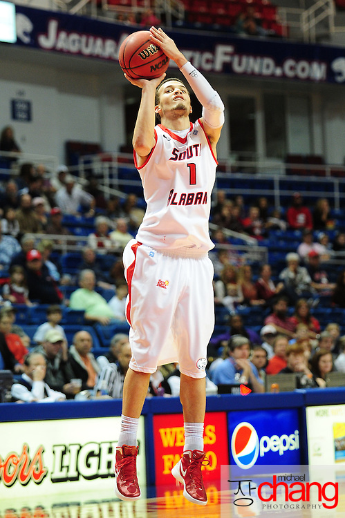 South Alabama's guard Trey Anderson (1) shoots a 3 point shot in the first half of play in Mobile, AL. Denver leads South Alabama 30-24 at halftime on January 7, 2012...
