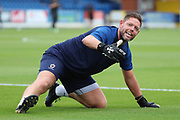 AFC Wimbledon goalkeeping coach Ashley Bayes warming up during the Pre-Season Friendly match between AFC Wimbledon and Bristol City at the Cherry Red Records Stadium, Kingston, England on 9 July 2019.