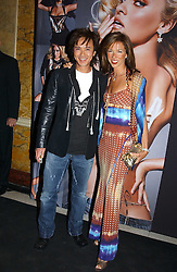 ANDY WONG and HEATHER KERZNER at a party to celebrate Pamela Anderson's new role as spokesperson and newest face of the MAC Aids Fund's Viva Glam V Campaign held at Home House, Portman Square, London on 21st April 2005.<br />