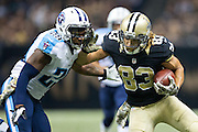 NEW ORLEANS, LA - NOVEMBER 8:  Willie Snead #83 of the New Orleans Saints stiff arms Perrish Cox #29 of the Tennessee Titans at Mercedes-Benz Superdome on November 8, 2015 in New Orleans, Louisiana.  The Titans defeated the Saints in overtime 34-28.  (Photo by Wesley Hitt/Getty Images) *** Local Caption *** Willie Snead; Perrish Cox