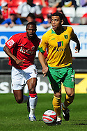 London - Saturday, April 17th 2010: Akpo Sodje of Charlton Athletic and Darel Russell of Norwich City during the Coca Cola League One match at The Valley, Charlton...(Pic by Alex Broadway/Focus Images)