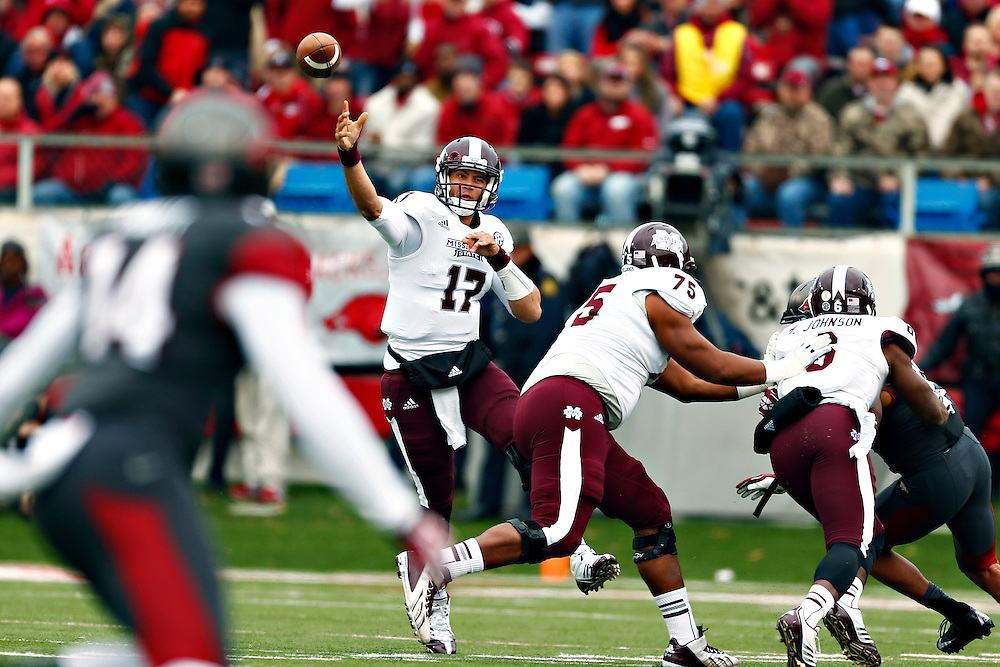 LITTLE ROCK, ARKANSAS - NOVEMBER 23:  Tyler Russell #17 of the Mississippi State Bulldogs throws a pass against the Arkansas Razorbacks at War Memorial Stadium on November 23, 2013 in Little Rock, Arkansas.  (Photo by Wesley Hitt/Getty Images) *** Local Caption *** Tyler Russell