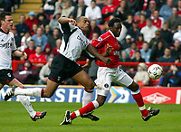 Photo. Chris Ratcliffe<br />Charlton v Fulham. FA Premiership. 11/05/2003<br />Alain Goma brngs down Jason Euel for the penalty which Euell then missed