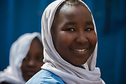 A Sudanese refugee girl participates in an assembly program at the St. Joseph community school December 14, 2017 in the Maadi district of Cairo, Egypt.