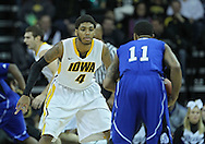 December 17, 2011: Iowa Hawkeyes guard/forward Roy Devyn Marble (4) eyes Drake Bulldogs guard Karl Madison (11) during the the NCAA basketball game between the Drake Bulldogs and the Iowa Hawkeyes at Carver-Hawkeye Arena in Iowa City, Iowa on Saturday, December 17, 2011. Iowa defeated Drake 82-68.