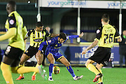 George Francomb of AFC Wimbledon and Matt McClure of Dagenham & Redbridge tussle during the Sky Bet League 2 match between AFC Wimbledon and Dagenham and Redbridge at the Cherry Red Records Stadium, Kingston, England on 24 November 2015. Photo by Stuart Butcher.