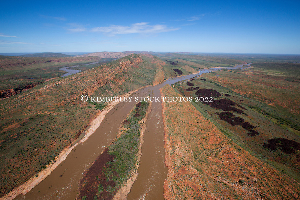 The Fitzroy River winds out of Dimond Gorge in the distance on Old Mornington Station.  In 1996 a campaign by Traditional owners and local environmentalists put a stop to a plan to dam the Fitzroy River at Dimond Gorge.