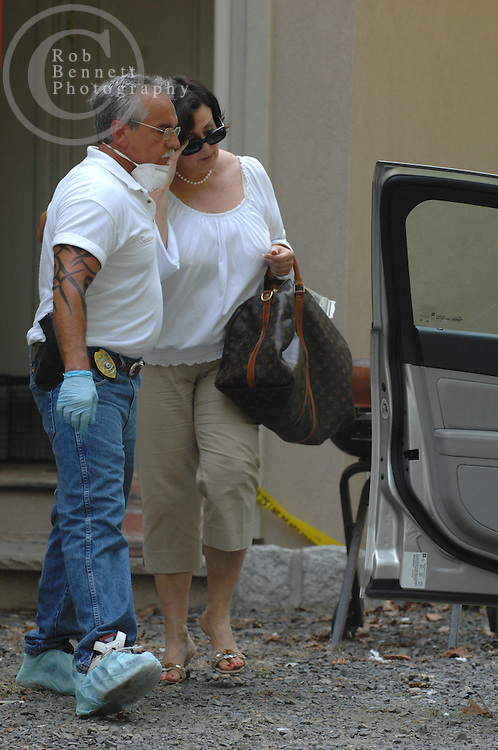 Here, Bergen County SPCA Deputy Chief Frank Saracino (L) escorts Cynthia Stewart, 49, from her former home Thursday afternoon. Stewart had returned to the property - now in foreclosure proceedings - to gather some of her belongings. She and her husband Philip Tamis, 66 are charged with animal cruelty offenses...---.Saddle River, NJ, - August 16, 2007 - Dozens of cats (most alive, some dead) found neglected in NJ mansion - Authorities Thursday continued to look for animals in a feces-ridden mansion in Saddle River (25 Burning Hollow Road) after removing at least 23 dead cats and dogs and rescuing dozens more pets - perhaps as many as 90...Rob Bennett for The New York Times