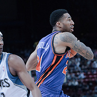 06 October 2010: New York Knicks forward Wilson Chandler #21 drives past Minnesota Timberwolves guard Corey Brewer during the Minnesota Timberwolves 106-100 victory over the New York Knicks, during 2010 NBA Europe Live, at the POPB Arena in Paris, France.