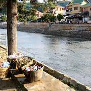 Woven baskets sit on the riverbank of the river in Sam Neua (also spelled Samneua, Xamneua and Xam Neua) in northeastern Laos.