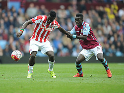 Mame Biram Diouf of Stoke City battles for the ball with Idrissa Gueye of Aston Villa - Mandatory byline: Alex James/JMP - 07966 386802 - 03/10/2015 - FOOTBALL - Villa Park - Birmingham, England - Aston Villa v Stoke City - Barclays Premier League