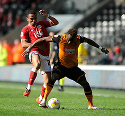 Moses Odubajo of Hull City holds the ball up from Peter Odemwingie - Mandatory by-line: Dougie Allward/JMP - 02/04/2016 - FOOTBALL - KC Stadium - Hull, England - Hull City v Bristol City - Sky Bet Championship