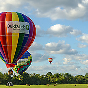 Two of the QuickCheck balloons coming in for a landing.  It is amazing the amount of skill and effort it takes to fly these.  You can see one of the support vehicles waiting for the ballons to land.