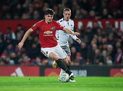 Harry Maguire of Manchester United in action - Mandatory by-line: Jack Phillips/JMP - 18/12/2019 - FOOTBALL - Old Trafford - Manchester, England - Manchester United v Colchester United - English League Cup Quarter Final