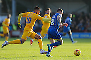 Barry Fuller (Captain) of AFC Wimbledon beats Matt Green of Mansfield Town to the ball during the Sky Bet League 2 match between AFC Wimbledon and Mansfield Town at the Cherry Red Records Stadium, Kingston, England on 16 January 2016. Photo by Stuart Butcher.