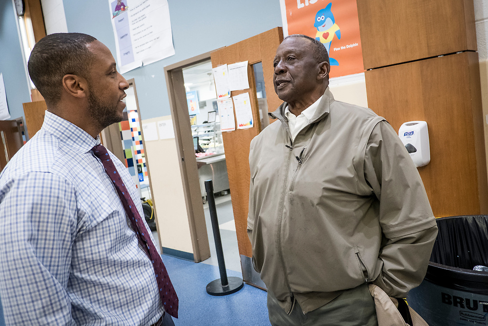 Eric Bethel, principal at Turner Elementary School in Washington, D.C., meets with former principal, Clemmie Strayhorn, who was head of the school from 1989-95, in the lunchroom on Wednesday, May 4, 2017. Strayhorn had dropped into the school to visit.