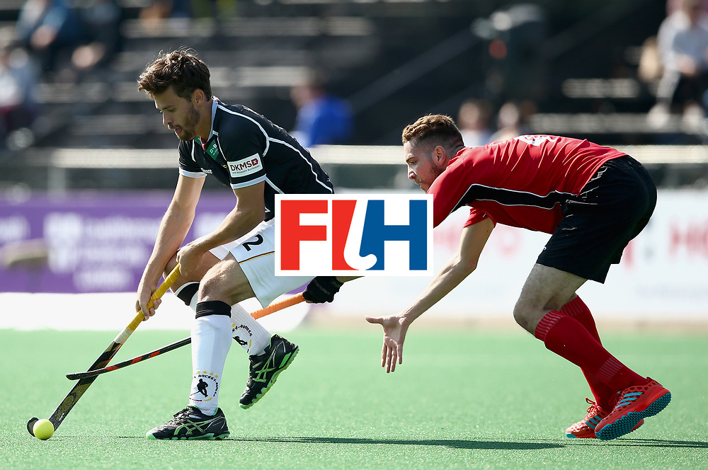 JOHANNESBURG, SOUTH AFRICA - JULY 11: Timm Herzbruch of Germany Karim Atef of Egypt battle for possession  during day 2 of the FIH Hockey World League Semi Finals Pool B match between Germany and Egypt at Wits University on July 11, 2017 in Johannesburg, South Africa. (Photo by Jan Kruger/Getty Images for FIH)
