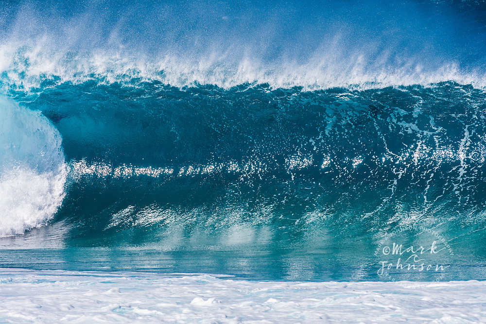 A beautiful blue wave breaking at the Banzai Pipeline, North Shore, Oahu, Hawaii