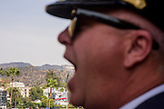 Hollywood, California - April 10, 2015: President Kevin Baugh of The Republic of Molossia looks to be eating the Hollywood Sign. Several MicroCon 2015 attendees toured the Hollywood Friday April 10, 2015. <br /> <br /> MicroCon 2015 is a Micronation conference.<br /> CREDIT: Matt Roth