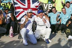 November 3, 2019, Austin, United States of America: Motorsports: FIA Formula One World Championship 2019, Grand Prix of United States, ..#44 Lewis Hamilton (GBR, Mercedes AMG Petronas Motorsport) celebrates winning the F1 World Drivers Championship 2019, #77 Valtteri Bottas (FIN, Mercedes AMG Petronas Motorsport) (Credit Image: © Hoch Zwei via ZUMA Wire)