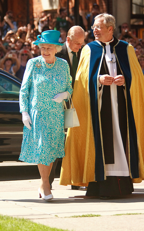 Queen Elizabeth II walks with the Very Reverend Douglas Stoute, Rector of St. James' Cathedral in Toronto, Canada as she and Prince Philip arrive for Sunday service July 4, 2010.<br /> AFP/GEOFF ROBINS/STR