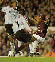 Photo: Leigh Quinnell.<br /> Arsenal v Fulham. The Barclays Premiership.<br /> 24/08/2005. Arsenals Thierry Henry squeezes a shot past Fulhams Luis Boa Morte.