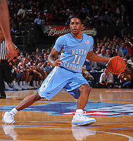 North Carolina guard Larry Drew II #11 brings the ball up the court  against the Ohio State Buckeyes during the 2K Sports Classic at Madison Square Garden. (Mandatory Credit: Delane B. Rouse/Delane Rouse Photography)