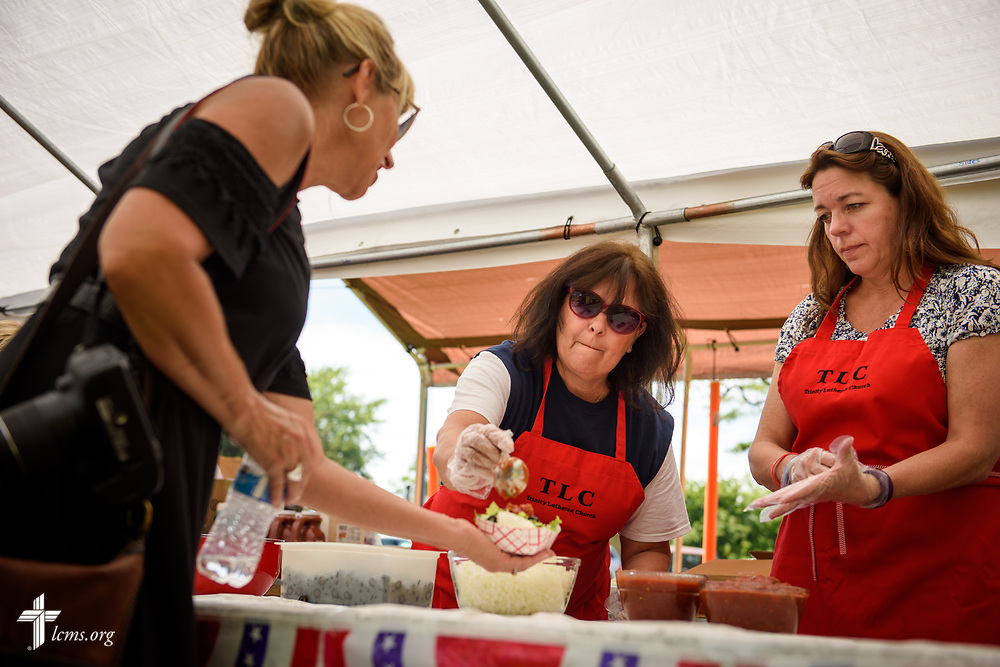 Volunteers from Trinity Lutheran Church, Grangeville, Idaho, prepare walking tacos for guests at the Grangeville Border Days Independence Day celebration and parade on Tuesday, July 4, 2017, in Grangeville. LCMS Communications/Erik M. Lunsford