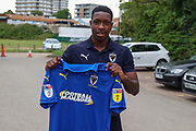 AFC Wimbledon attacker Michael Folivi holding up AFC Wimbledon shirt during the Pre-Season Friendly match between AFC Wimbledon and Bristol City at the Cherry Red Records Stadium, Kingston, England on 9 July 2019.