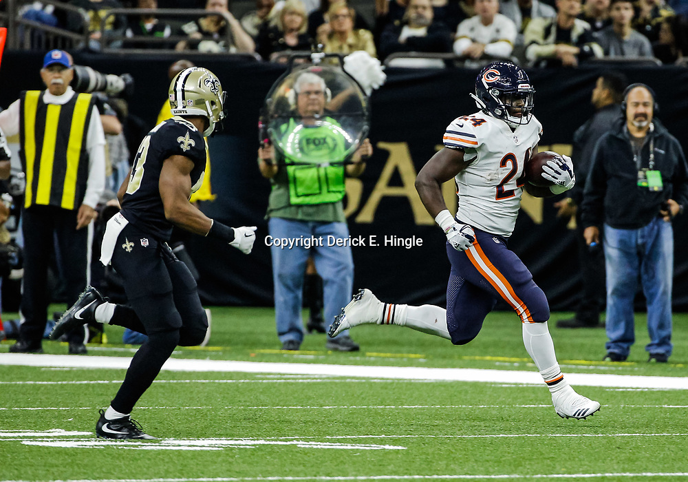 Oct 29, 2017; New Orleans, LA, USA; Chicago Bears running back Jordan Howard (24) runs past New Orleans Saints cornerback Marshon Lattimore (23) during the second half of a game at the Mercedes-Benz Superdome. The Saints defeated the Bears 20-12. Mandatory Credit: Derick E. Hingle-USA TODAY Sports