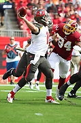 Nov 11, 2018; Tampa, FL USA: Tampa Bay Buccaneers quarterback Ryan Fitzpatrick (14) throws a pass against the Washington Redskins at Raymond James Stadium. The Redskins beat the Buccaneers 16-3. (Steve Jacobson/Image of Sport)