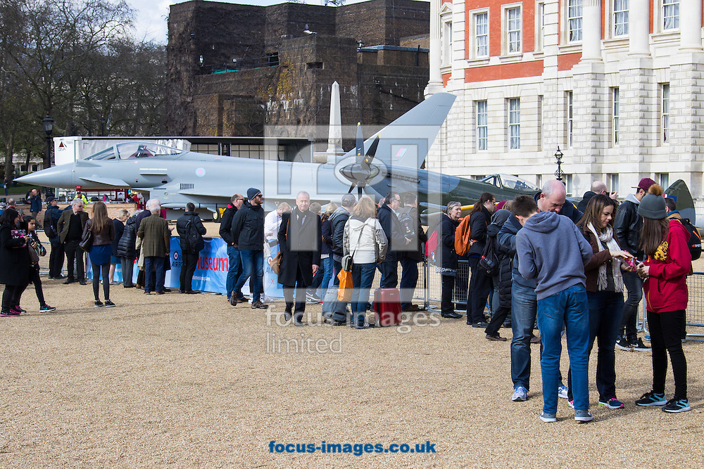 Crowds gather to look at a Eurofighter Typhoon, a Spitfire Mk XVI and a 1918 Sopwith Snipe as the Royal Air Force Museum promotes the forthcoming 100th anniversary of the Royal Air Force in 2018 with a static display of warplanes in Horseguards Parade, Westminster.<br /> Picture by Paul Davey/Focus Images Ltd +447966 016296<br /> 31/03/2016