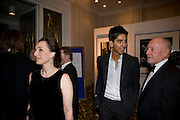Kristen Scott Thomas;  Dev Patel, The London Critics' Circle Film Awards 2009 in aid of the NSNCC. Grosvenor House Hotel . Park Lane. London. 4 February 2009 *** Local Caption *** -DO NOT ARCHIVE -Copyright Photograph by Dafydd Jones. 248 Clapham Rd. London SW9 0PZ. Tel 0207 820 0771. www.dafjones.com<br /> Kristen Scott Thomas;  Dev Patel, The London Critics' Circle Film Awards 2009 in aid of the NSNCC. Grosvenor House Hotel . Park Lane. London. 4 February 2009
