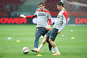 Poland's goalkeeper Wojciech Szczesny (L) fights for the ball with Poland's Robert Lewandowski (R) during official training one day before the EURO 2016 qualifying match between Poland and Germany on October 10, 2014 at the National stadium in Warsaw, Poland<br /> <br /> Picture also available in RAW (NEF) or TIFF format on special request.<br /> <br /> For editorial use only. Any commercial or promotional use requires permission.<br /> <br /> Mandatory credit:<br /> Photo by &copy; Adam Nurkiewicz / Mediasport