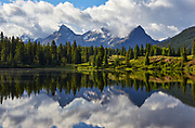 Morning reflections of peaks in the San Juan mountains at Molas Lake, Colorado