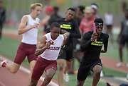 Phillip Jefferson  of Long Beach Wilson (left) and DeAngelo Chester of Long Beach Poly run the third leg in the 4 x 400m relay during the 2019 CIF Southern Section Masters Meet in Torrance, Calif., Saturday, May 18, 2019. Wilson won in 3:11.86. Poly placed fourth in 3:15.07.