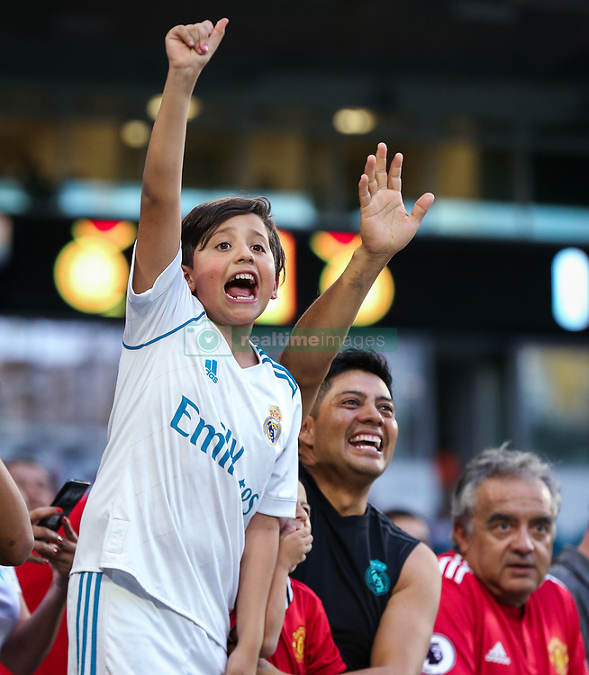 July 31, 2018 - Miami Gardens, Florida, U.S. - Fans wave at players entering the field at the beginning of an International Champions Cup match between Real Madrid C.F. and Manchester United F.C. at the Hard Rock Stadium. Manchester United F.C. won the game 2-1. (Credit Image: © Mario Houben via ZUMA Wire)