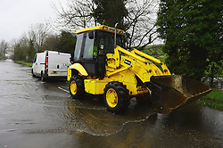 A vehicle trying to drive through the water as the UK starts to sink. Photo taken on the edge of Wraysbury, UK. Tuesday, 11th February 2014. Picture by Andrew Parsons / i-Images