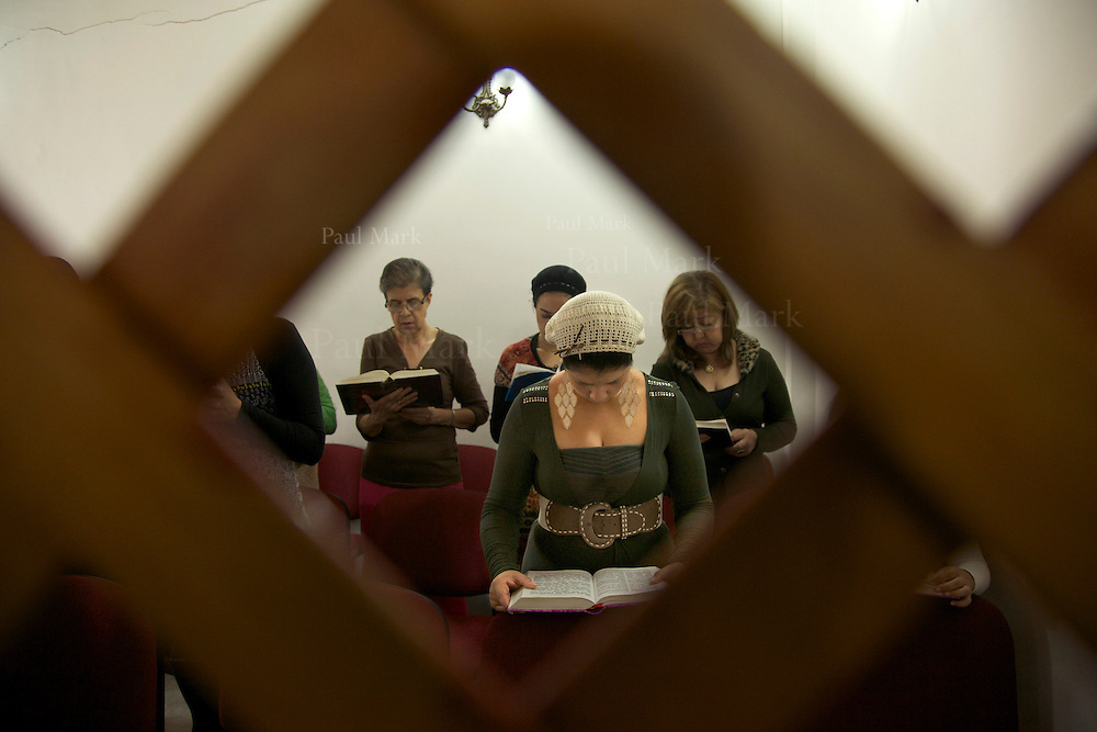 BELLO, COLOMBIA - November 4: Women of the Jewish community in Bello recite prayers in the synagogue.