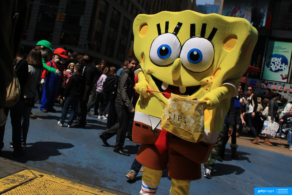 An entertainer dressed as a cartoon character looks for tips in Time Square, New York. Times Squares' costumed entrepreneurs are officially free to ply their trade without fear of retribution.  The entertainers are allowed to receive tips, but not charge for pictures taken with them in costume. Times Square is the major commercial intersection in Midtown Manhattan. Time Square, New York, USA. 27th April 2012. Photo Tim Clayton