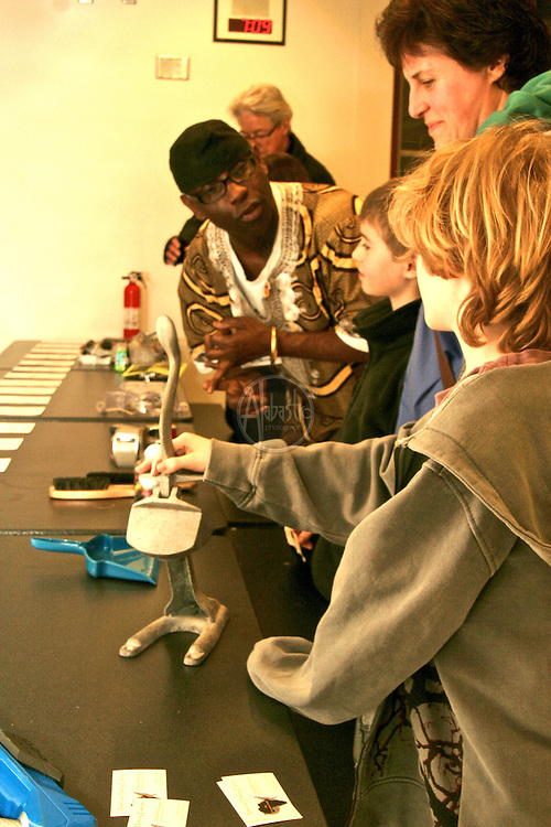 science historian Delbert Richardson presenting history of African American Inventors at Hamilton International Middle School Science Night 2010