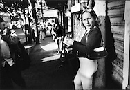 "La Paradita (""standing girl""). Prostitute lines up for selection of passing male customers in the La Coahuila red light district, which is just a couple of hundred meters from the border, Tijuana, Mexico."
