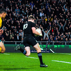 Fans celebrate as Beauden Barrett heads for the tryline to score the matchwinner during the Rugby Championship and Bledisloe Cup rugby match between the New Zealand All Blacks and Australia Wallabies at Forsyth Barr Stadium in Dunedin, New Zealand on Saturday, 26 August 2017. Photo: Dave Lintott / lintottphoto.co.nz