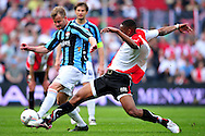 Onderwerp/Subject: Feyenoord - Willem II - Eredivisie<br /> Reklame:  <br /> Club/Team/Country: Feyenoord - Willem II<br /> Seizoen/Season: 2010/2011<br /> FOTO/PHOTO: Feyenoord's Leroy FER (R) in duel with Willem II's Andreas LASNIK (L). (Photo by PICS UNITED)<br /> <br /> Trefwoorden/Keywords:  <br /> #04 $94 &plusmn;1279295324043<br /> Photo- &amp; Copyrights &copy; PICS UNITED <br /> P.O. Box 7164 - 5605 BE  EINDHOVEN (THE NETHERLANDS) <br /> Phone +31 (0)40 296 28 00 <br /> Fax +31 (0) 40 248 47 43 <br /> http://www.pics-united.com <br /> e-mail : sales@pics-united.com (If you would like to raise any issues regarding any aspects of products / service of PICS UNITED) or <br /> e-mail : sales@pics-united.com   <br /> <br /> ATTENTIE: <br /> Publicatie ook bij aanbieding door derden is slechts toegestaan na verkregen toestemming van Pics United. <br /> VOLLEDIGE NAAMSVERMELDING IS VERPLICHT! (&copy; PICS UNITED/Naam Fotograaf, zie veld 4 van de bestandsinfo 'credits') <br /> ATTENTION:  <br /> &copy; Pics United. Reproduction/publication of this photo by any parties is only permitted after authorisation is sought and obtained from  PICS UNITED- THE NETHERLANDS