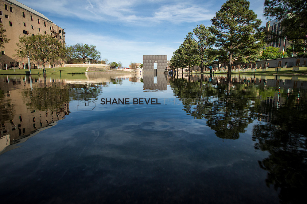 4/9/15 5:41:30 PM -- Oklahoma City, OK, U.S.A  -- The Reflecting Pool at the Oklahoma City National Memorial. A look at Oklahoma City, twenty years after the bombing of the Alfred P. Murrah Federal Building in 1995. --    Photo by Shane Bevel, Freelance