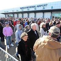 Area residents and Trump supporters wait in line oustside the Tupelo Regional Airport  to see President Donald Trump Tupelo Monday afternoon.
