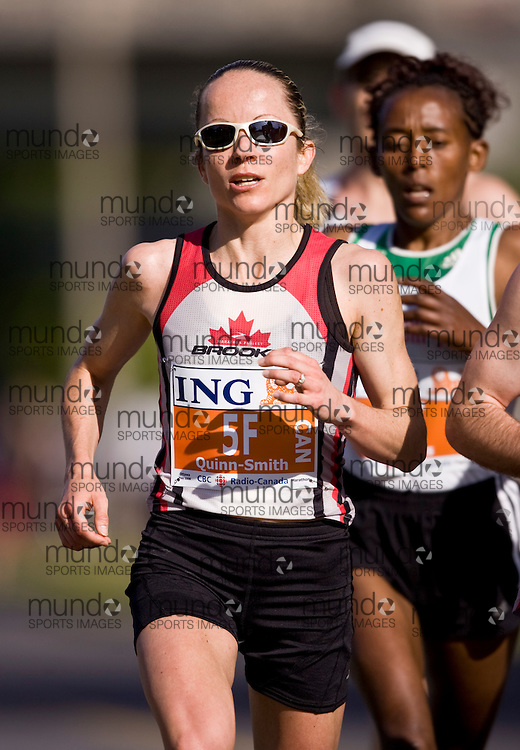 Ottawa, Ontario ---25/05/08--- Tara Quinn-Smith runs during the ING Ottawa Marathon, May 26, 2008..GEOFF ROBINS /